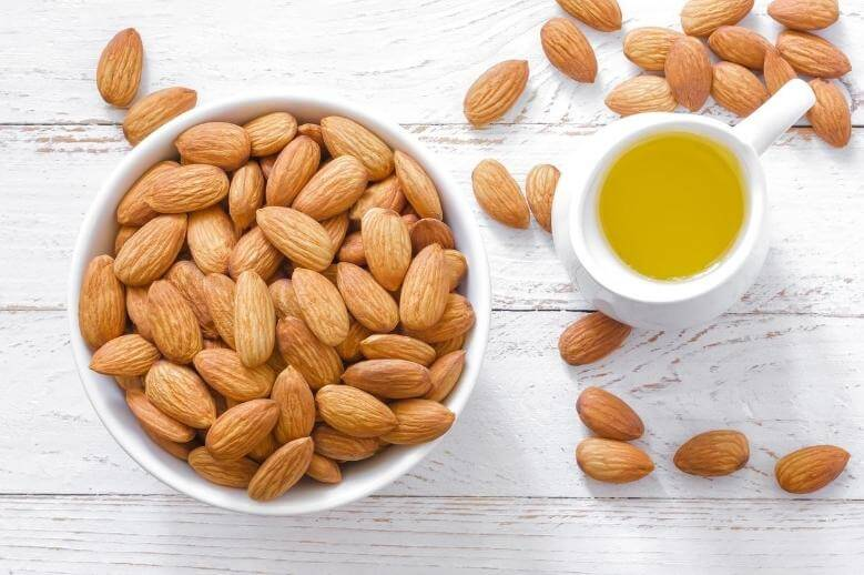 bowl of almonds and almond oil