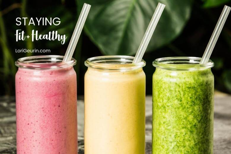 healthy smoothies in glasses with straws