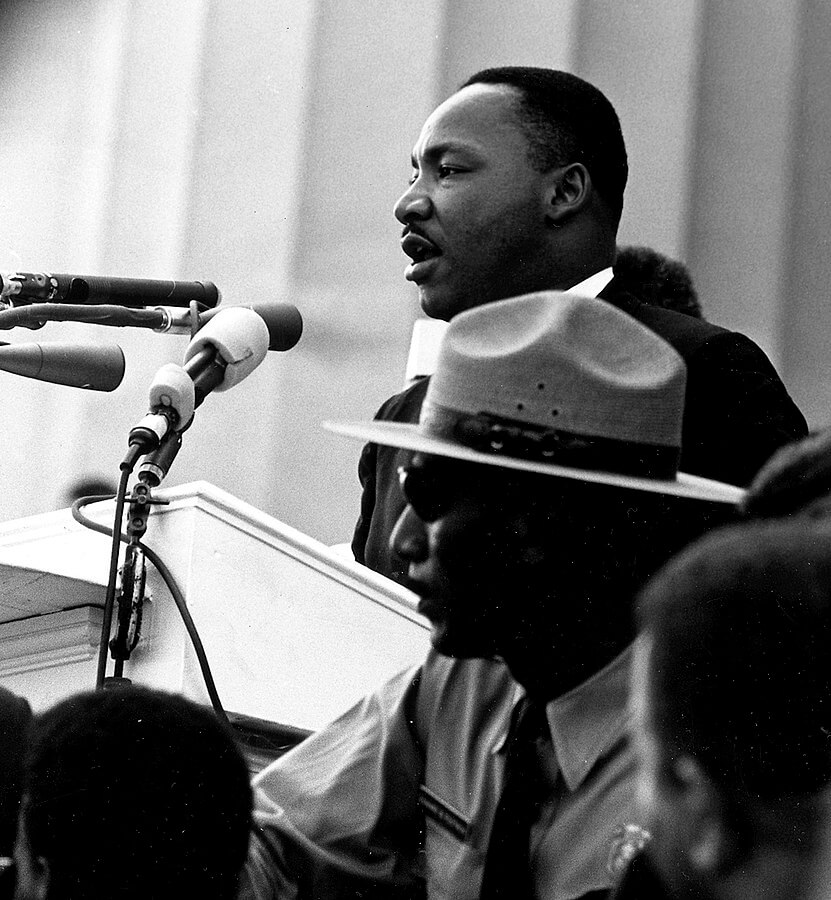 Martin Luther King Jr. giving his I Have A Dream speech at a podium