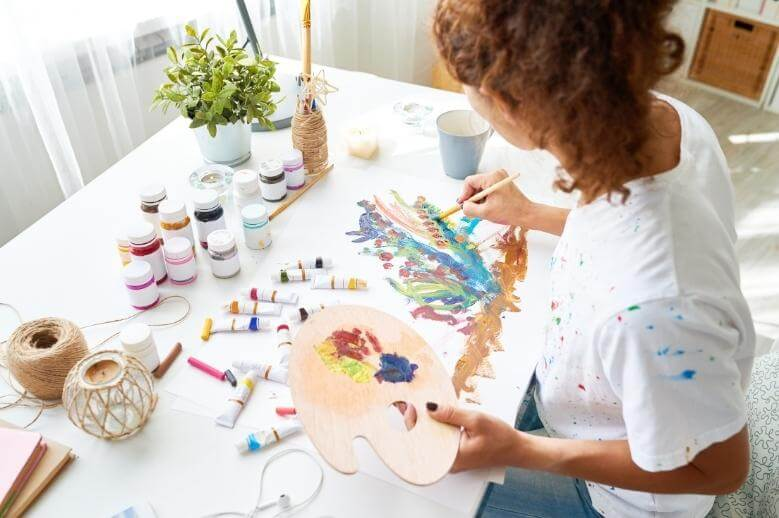 an artist painting  a picture
