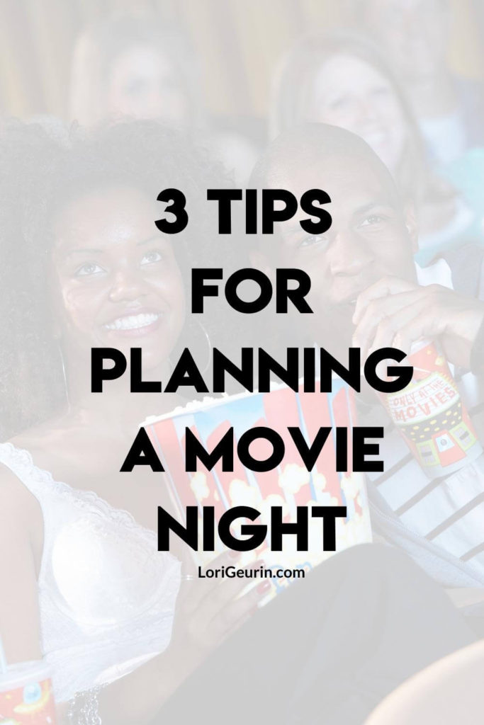 tips for planning a movie night at home / a couple eating popcorn and drinking soda watching the movies at home
