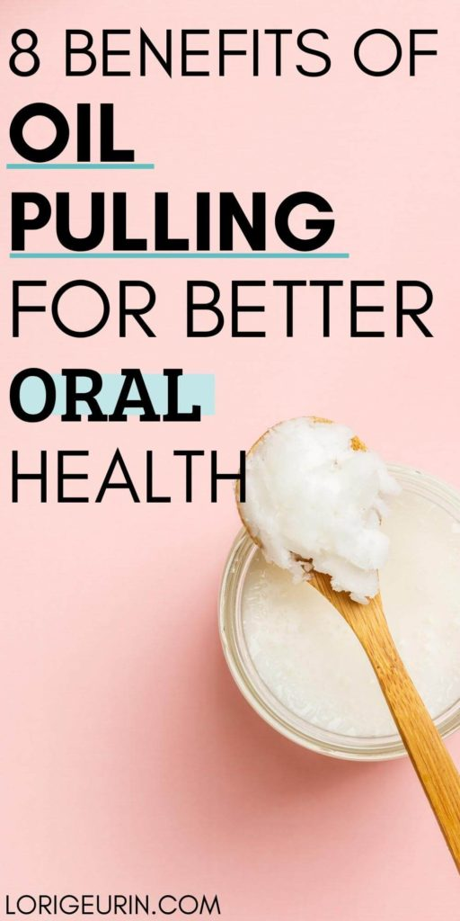 oil pulling benefits /coconut oil in a glass jar  with a spoon