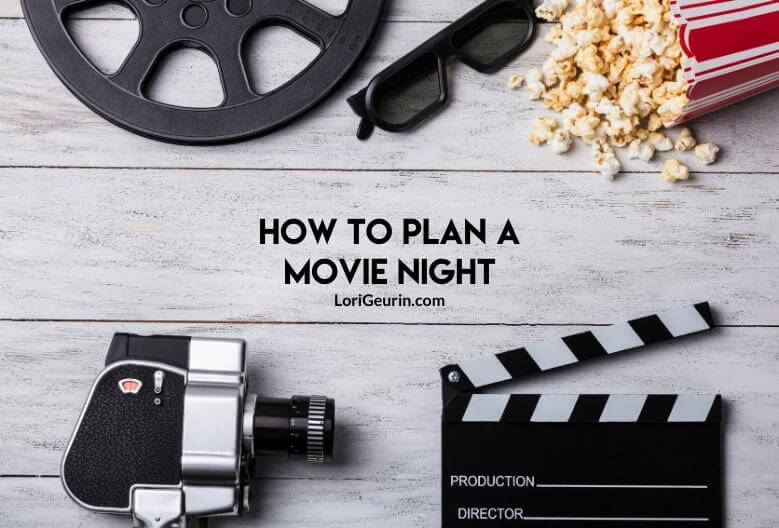 Planning a movie night at home / a video camera with popcorn on a wooden table