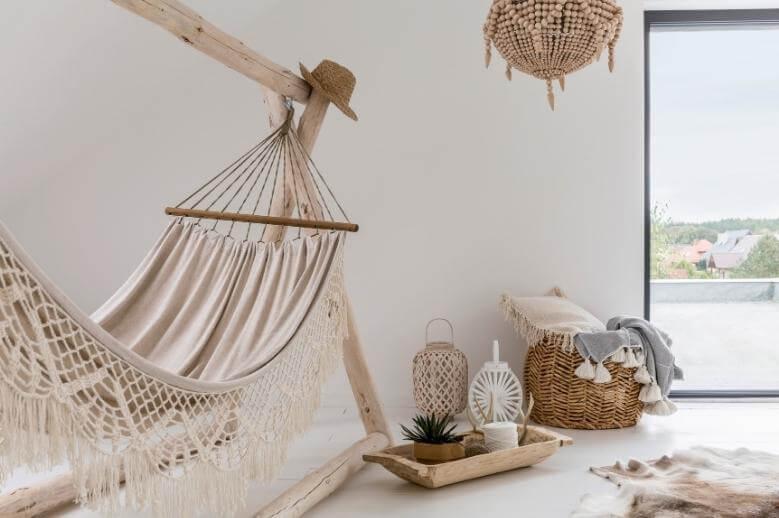 a white hammock in a simple white boho room