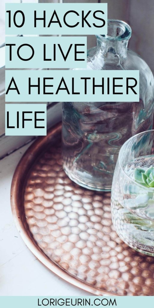 10 health and wellness habits / a pitcher of fresh water to drink next to a glass of water with fresh herbs on a copper tray