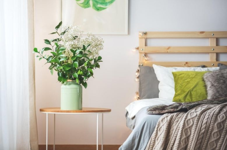 how to sleep better with chronic back pain, bedroom with a bed and flowers