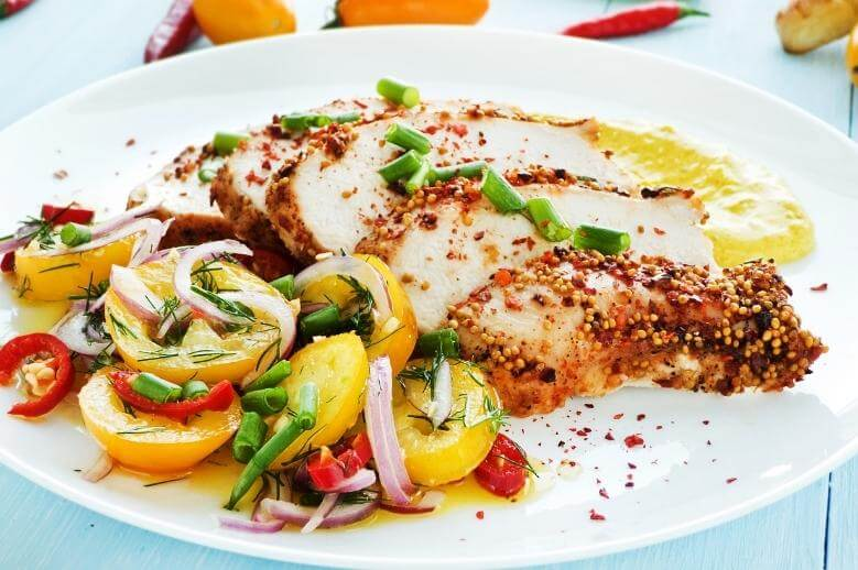 healthy dinner on a plate with chicken with vegetables
