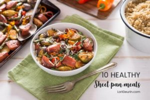 healthy sheet pan meals - a bowl of potatoes and meat, a fork, and a napkin