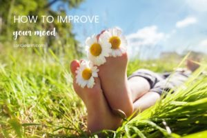 feet in a field with sunflowers and grass
