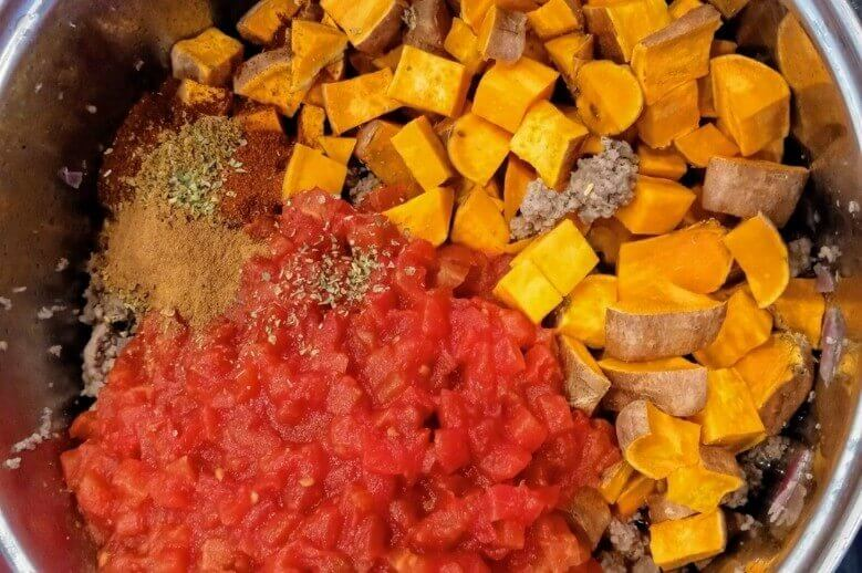 sweet potato chili ingredients cooking in a pot
