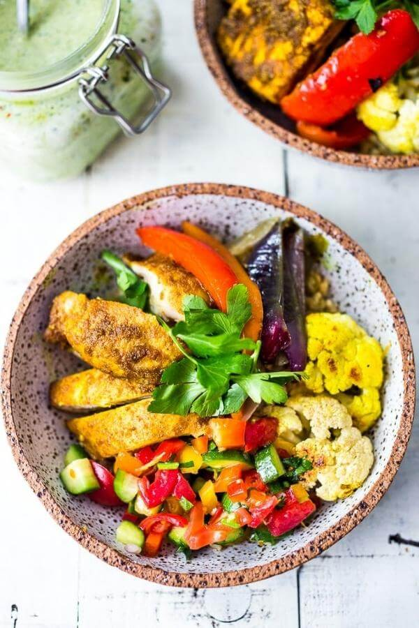 chicken shawarma with vegetables in bowls