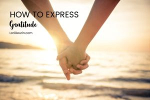 couple holding hands at sunset at the beach express gratitude