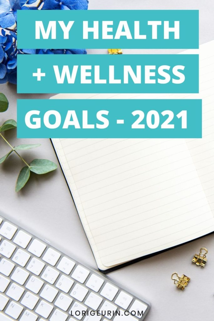 personal health and wellness goals and notebook with pen and blue flowers