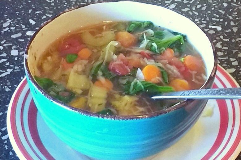 vegetable soup in blue bowl