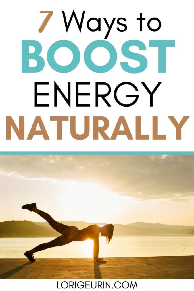 how to boost your energy / woman doing yoga plank at sunrise on the beach