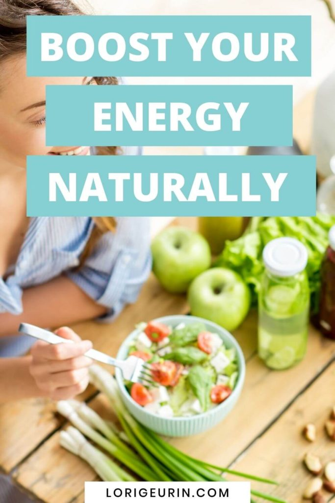 how to boost your energy levels naturally / a woman eating a healthy salad in the sunshine