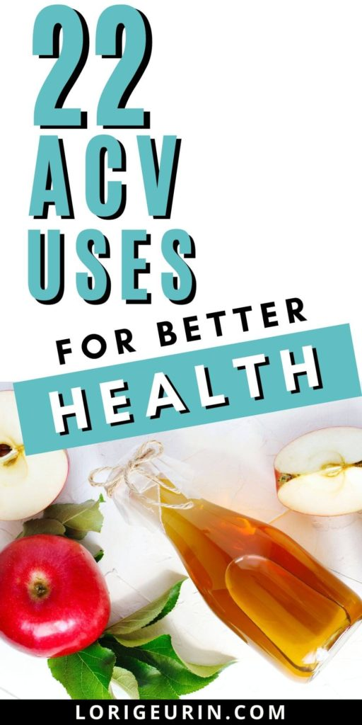 apple cider vinegar / ACV, and apples on a white table with leaves
