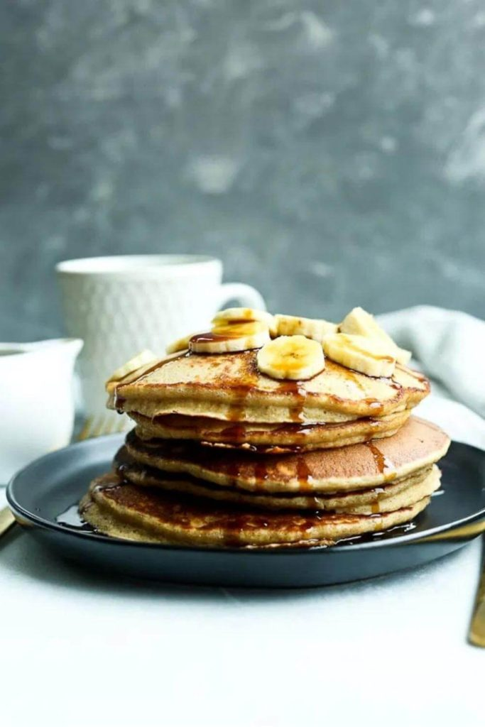healthy pancakes with bananas on a black plate