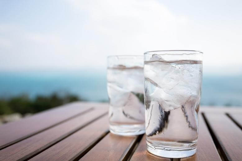 clean fasting / 2 glasses of ice water on a wooden table