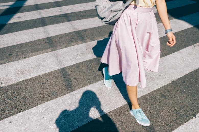 young woman walking in sneakers
