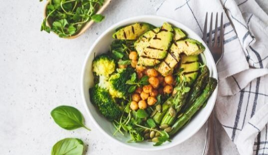 healthy buddha bowl of chicken and vegetables