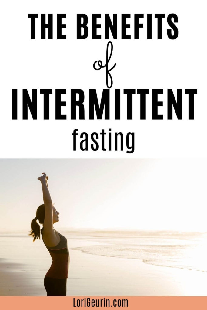 benefits of fasting / woman stretching at the beach