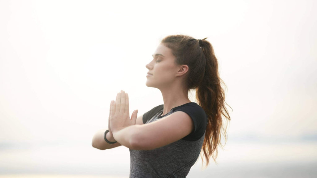 how to change your mindset / woman doing yoga